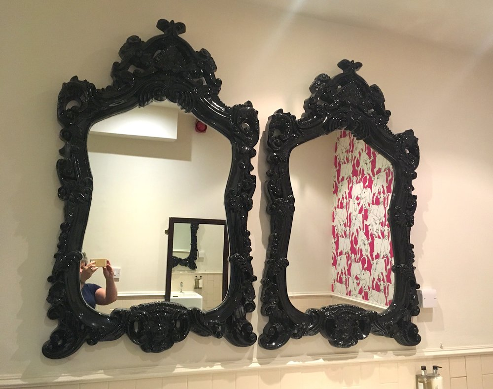 Two huge and grand mirrors in the ladies at the Crown Inn in Framlingham
