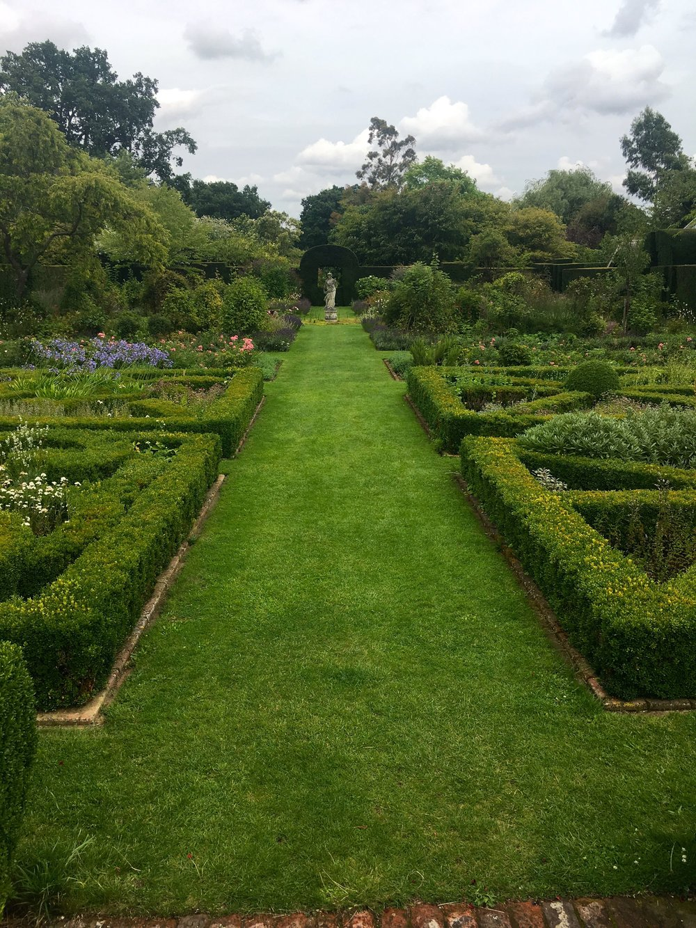 the central grassed walkway in the knot garden at helmington hall