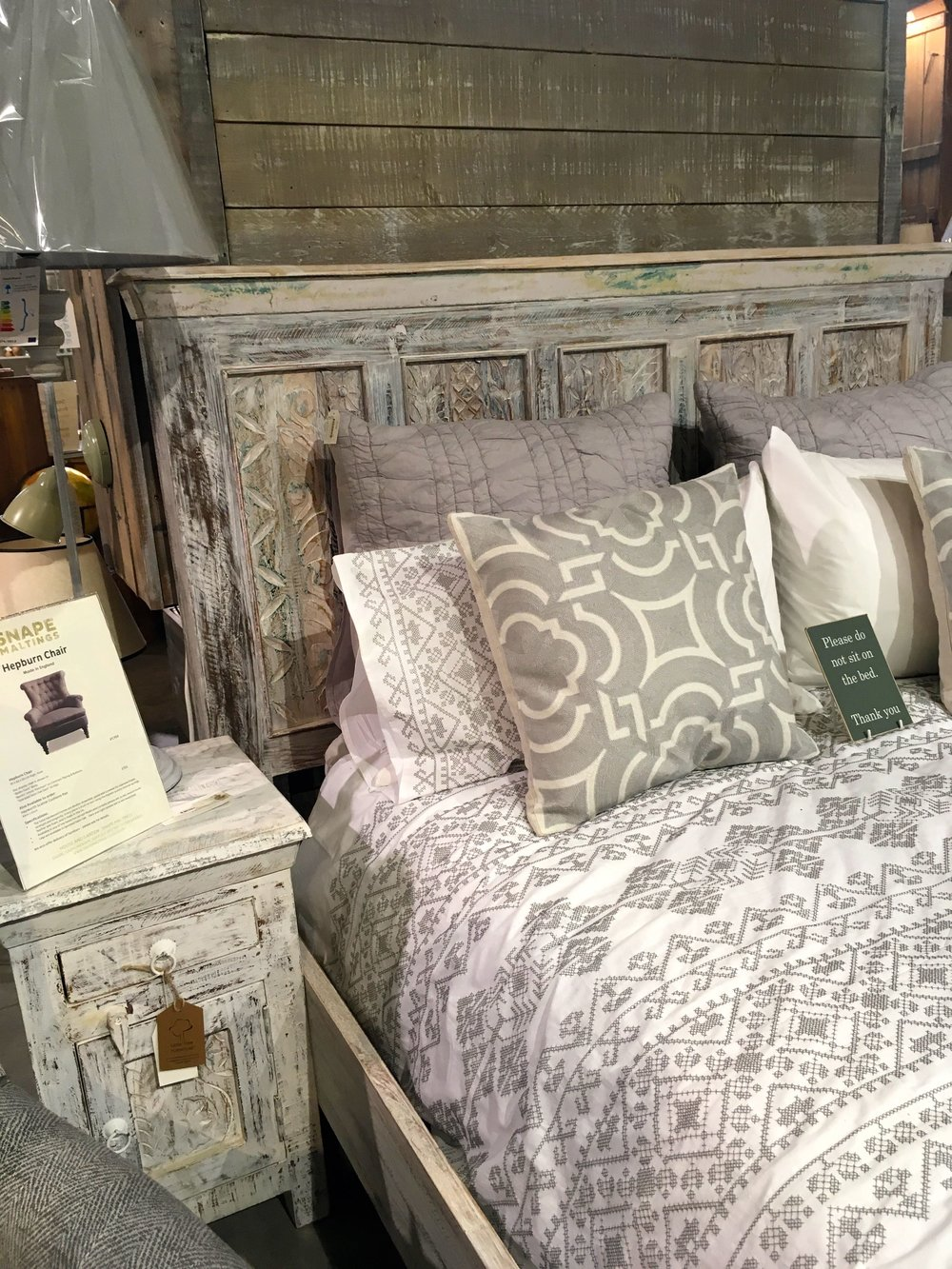 Textured wood and patterned bed linen in the Homes & Gardens shop at Snape Malting Suffolk