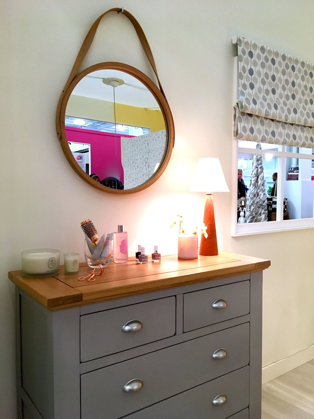 A mirror above a chest of drawers at the Ideal Home Show