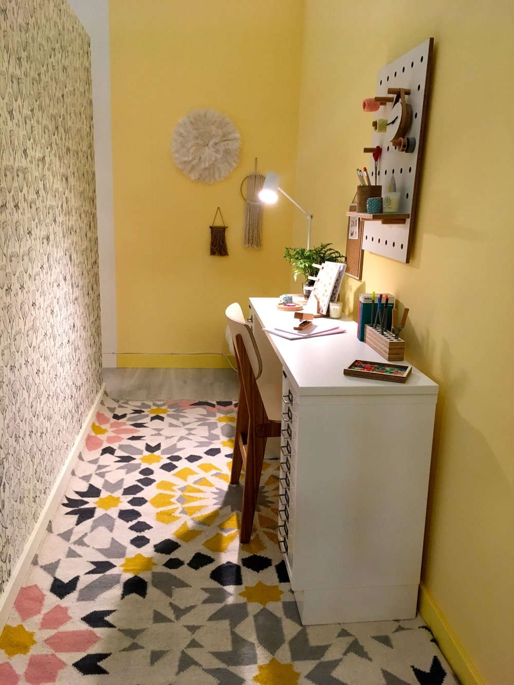 A false wall conceals an office space at the Ideal Home Show