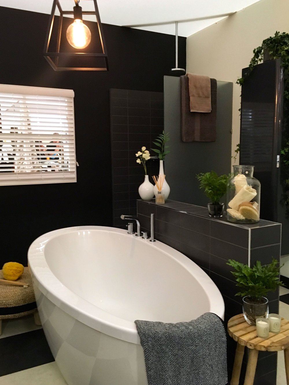 the shower cubicle in the corner of the bathroom room set at the Ideal Home show