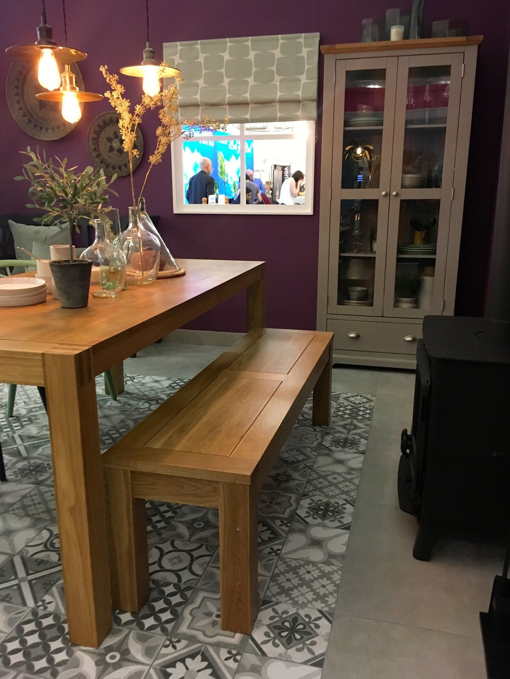 bench seating and storage in the dining room set at the Ideal Home Show