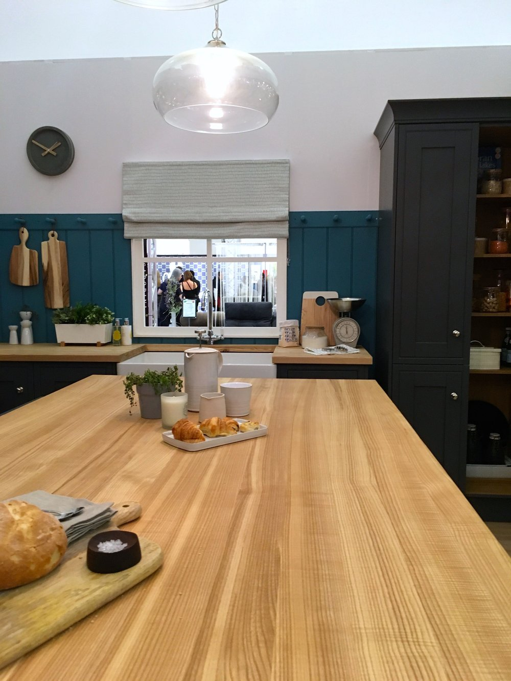 A large central island in the kitchen roomset at the ideal home show