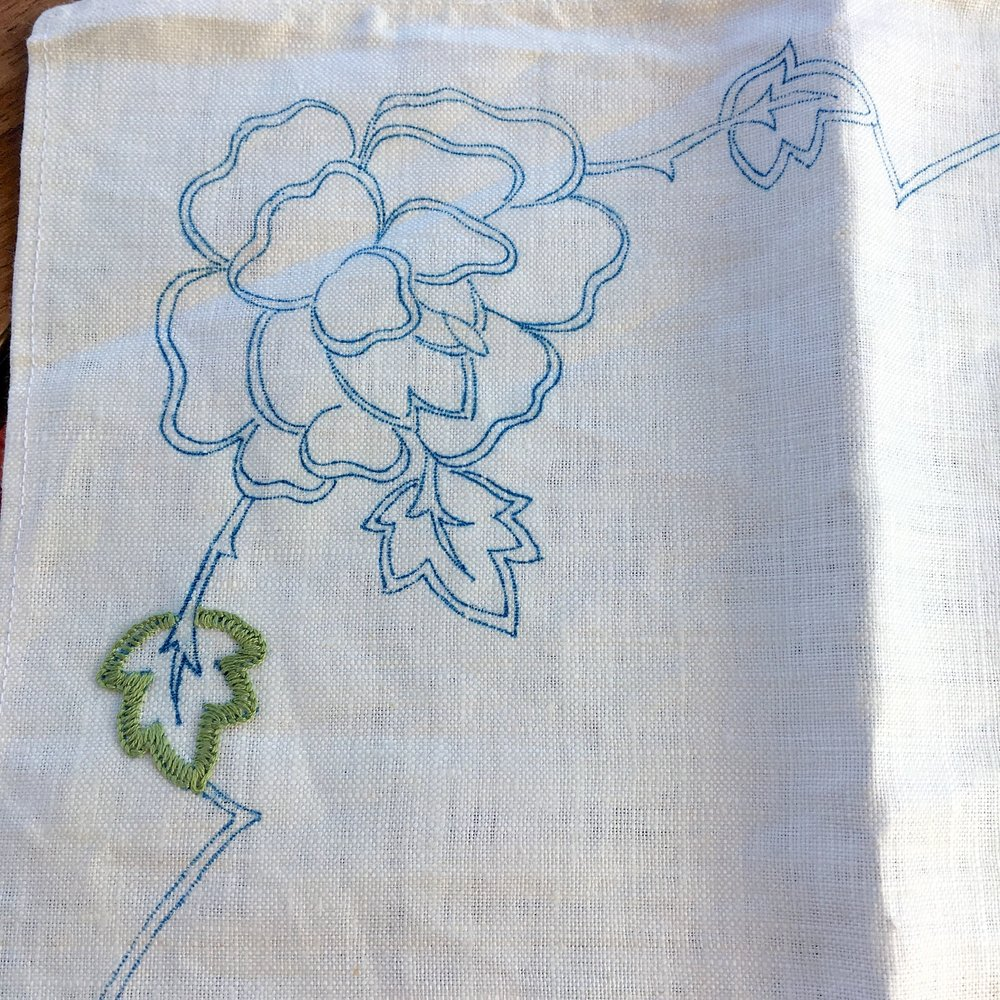 My linen tablecloth embroidery project - just a leaf started in this corner
