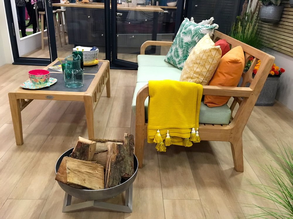 A colourful place to sit  in the living room at the Ideal Home Show roomset