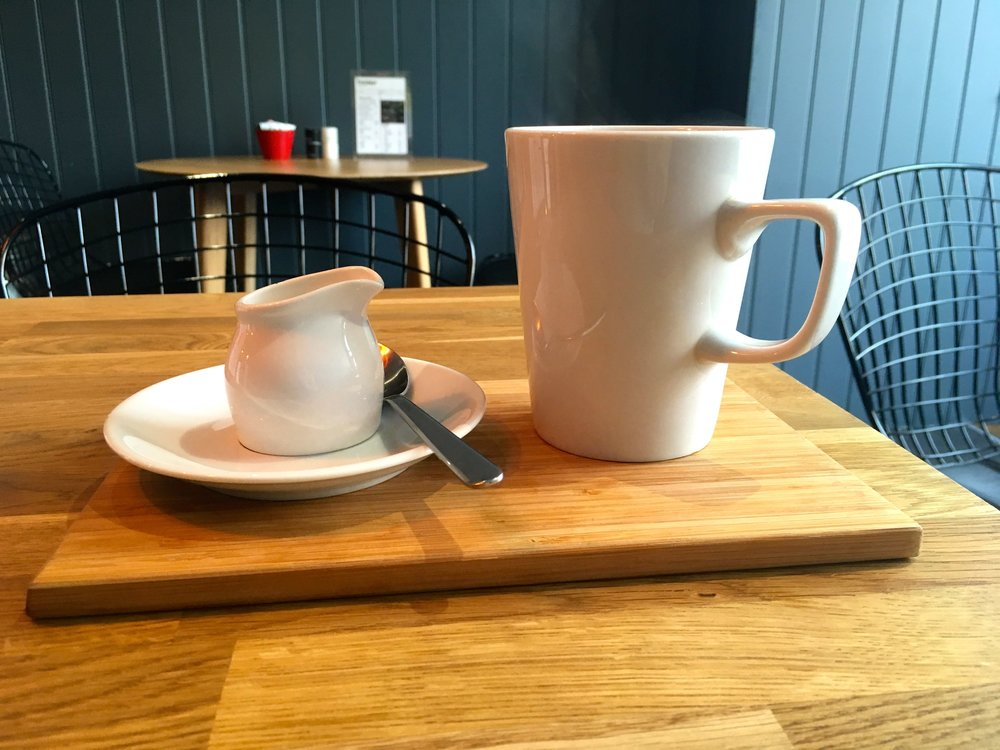 A mug of tea served on a board at the Trafalgar Cafe in Greenwich