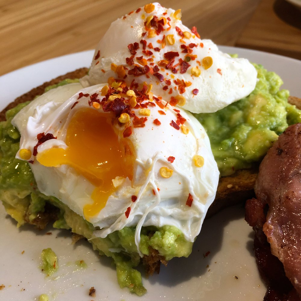 avocado on toast with poached eggs at the Trafalgar Cafe