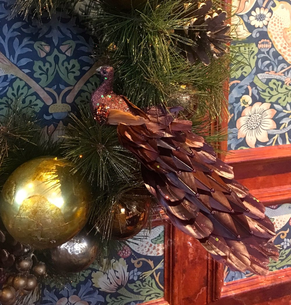 a bird in the wreath, surely there's a saying for that