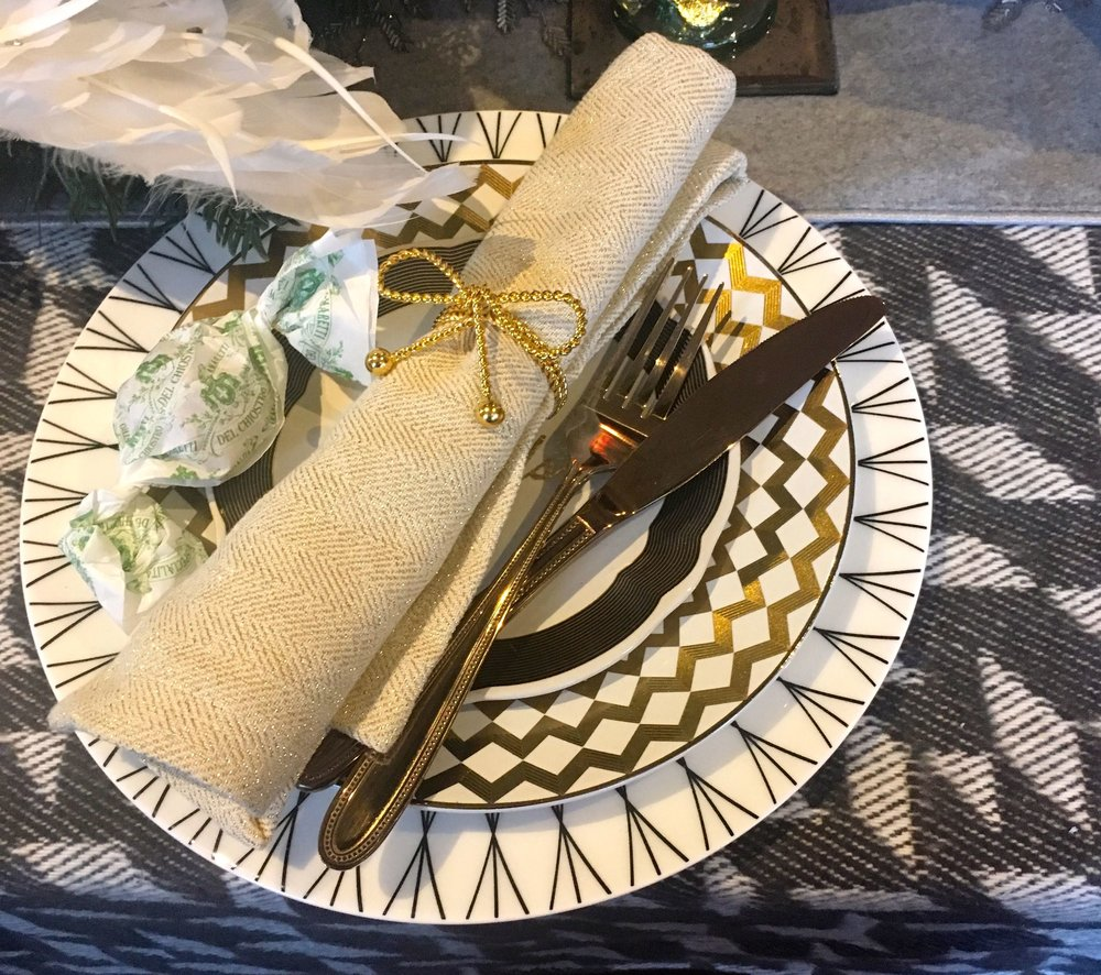 A gold place setting from HomeSense