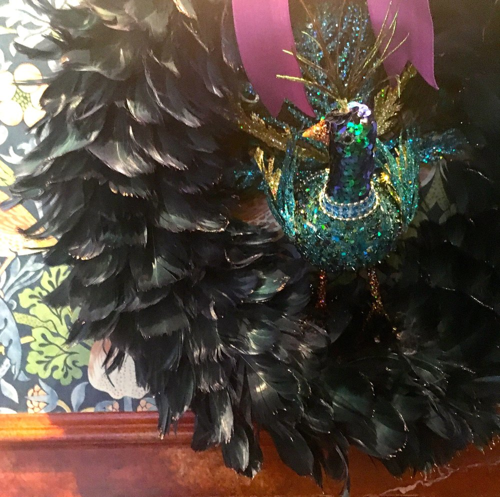 A black feather wreath with a jewelled bird from HomeSense
