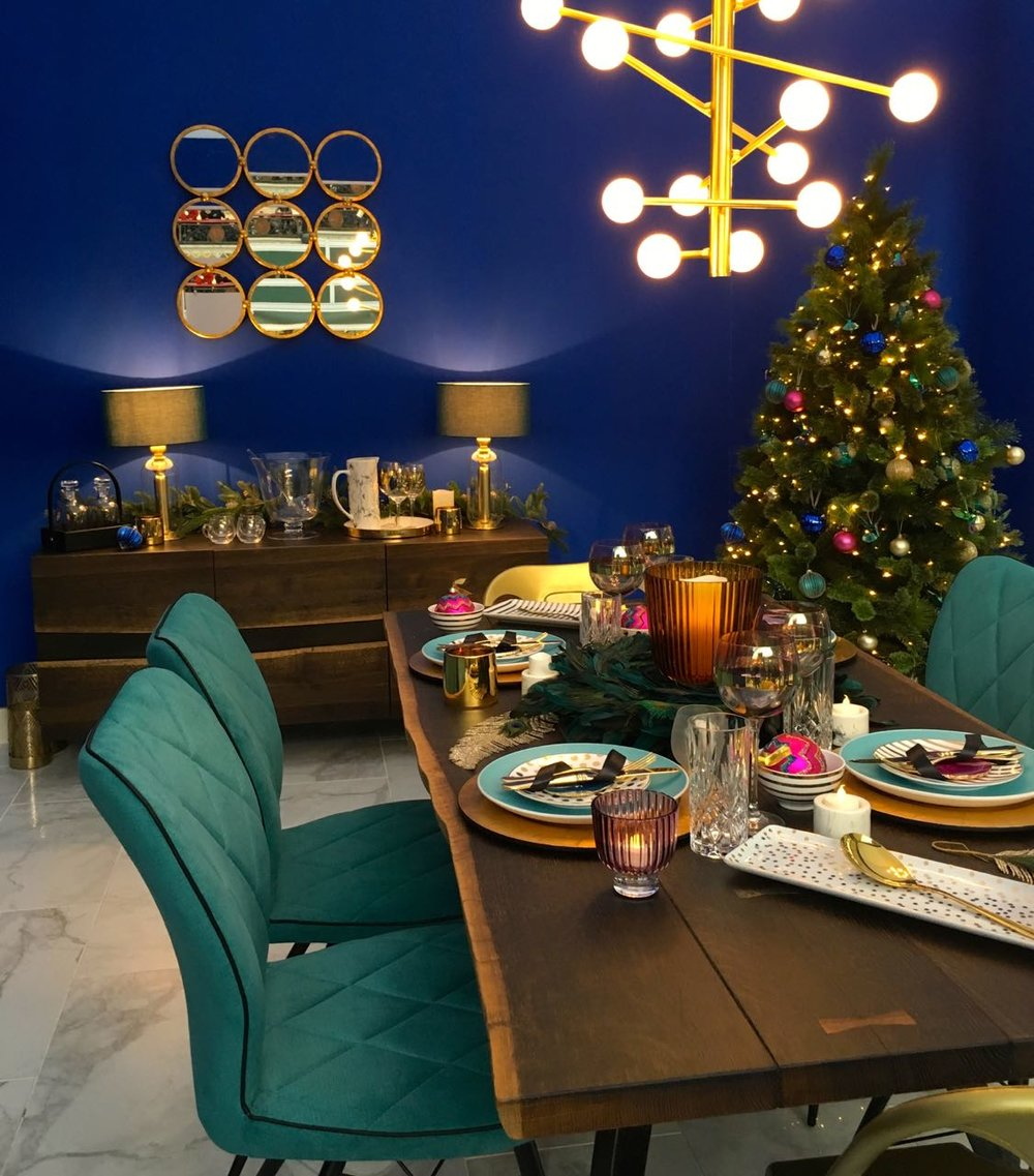 Cobalt blue and precious metals in this room set at the Ideal Home Show at Christmas