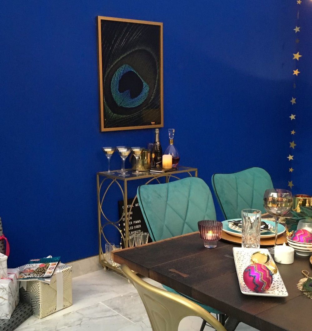 A line of stars and bold colours in this room set at the Ideal Home Show at Christmas