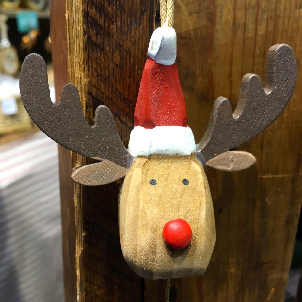 A WOODEN REINDEER WITH CHARACTER