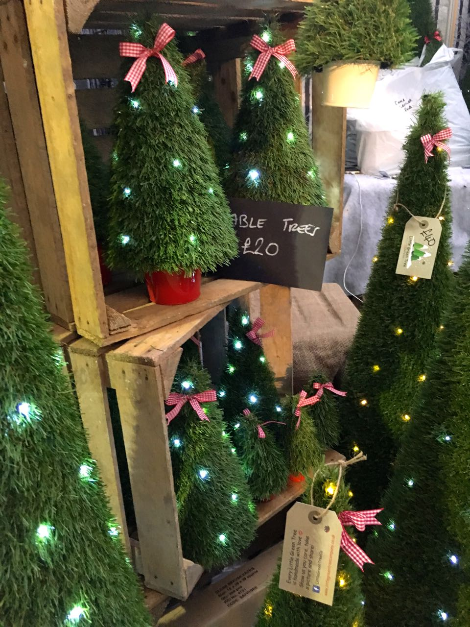 FAUX CHRISTMAS TREES OF EVERY SIZE at the Ideal Home Show at Christmas