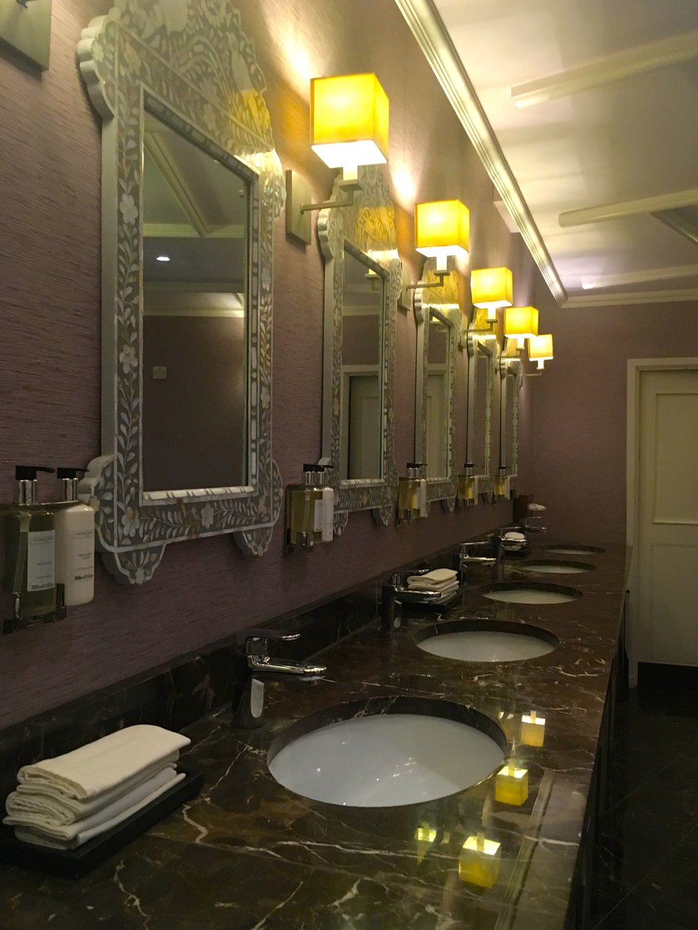 A row of mother of pearl mirrors at St Ermin's hotel in London