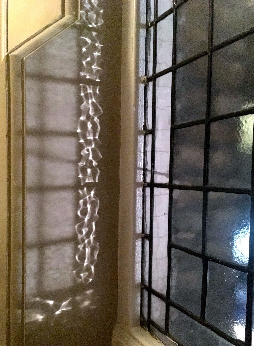 patterned light reflecting on the wall at St Ermin's hotel in London