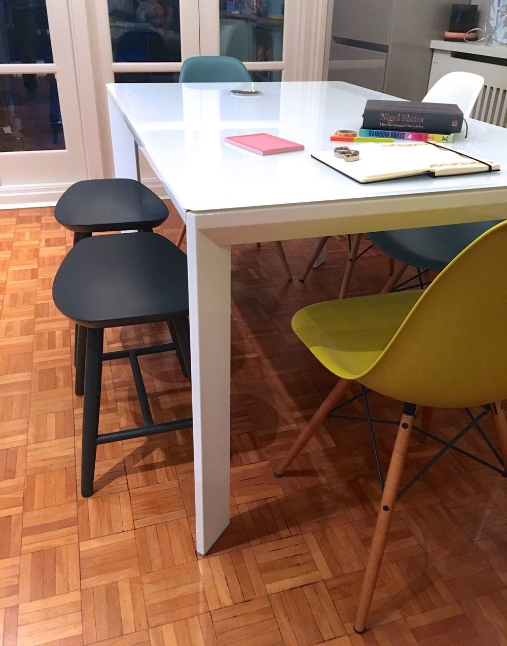 The stools (from Cult Furniture) provide more flexibility than a bench would