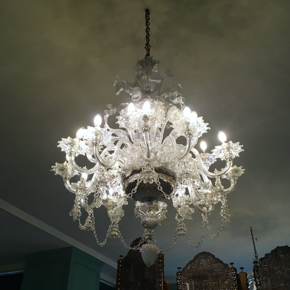 DESPITE CONVERTING IT TO A STORE ROOM THE CHANDELIERS STAYED