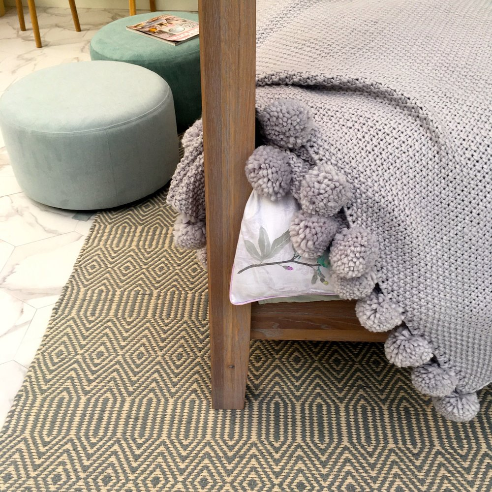 Pom Pom edging in the bedroom room set at the Ideal Home Show