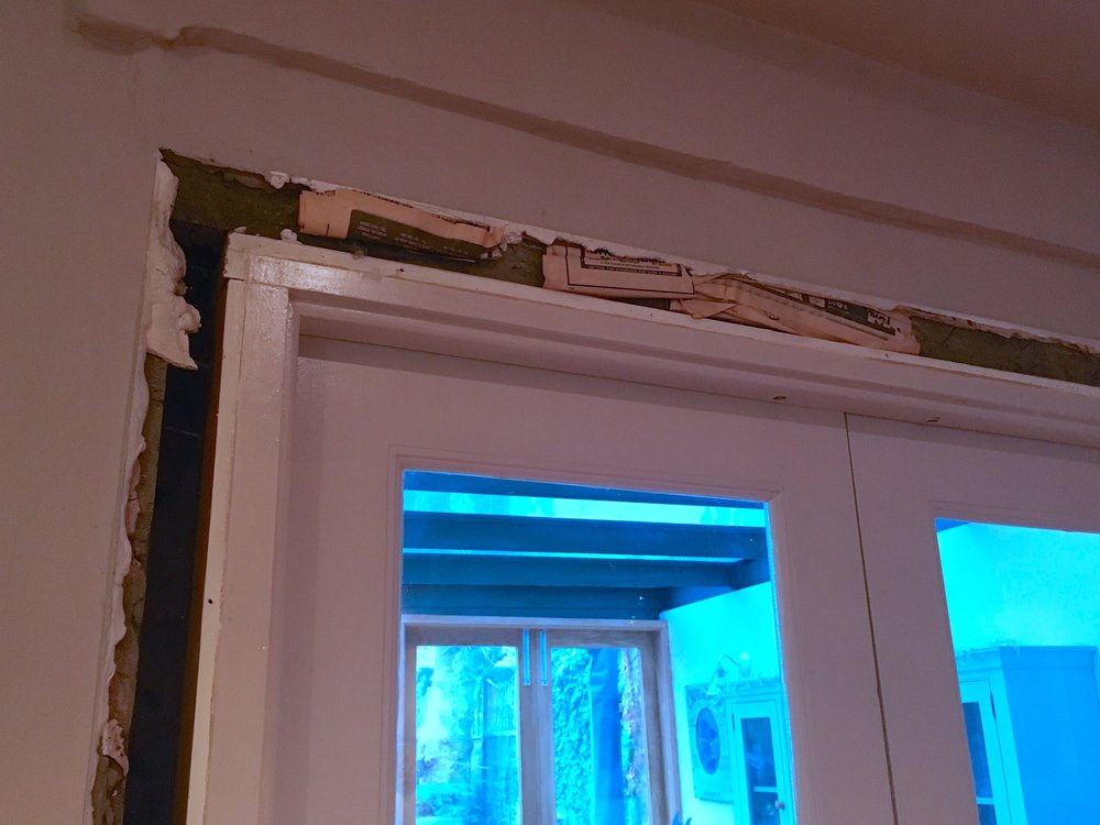 Newspaper packing out the architrave