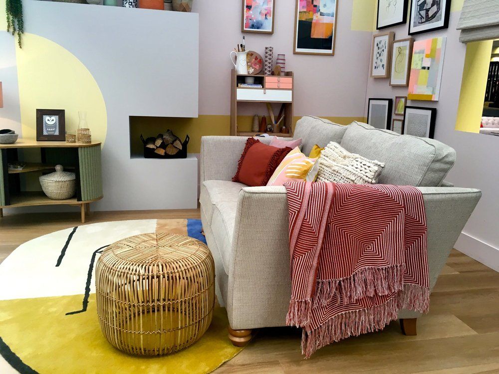 a side view of the family room at the ideal home show