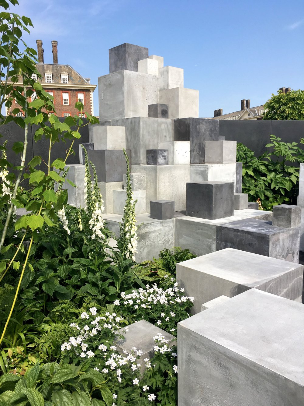 THE TEXTURAL BLOCKS IN THE SILVER-GILT MEDAL SPACE TO GROW SKIN DEEP GARDEN