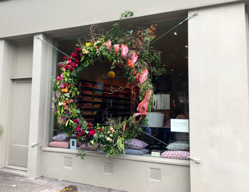 A floral wreath the size of a shop window