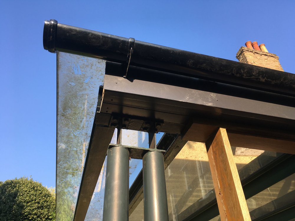a new gutter and blue skies (and a dirty roof)