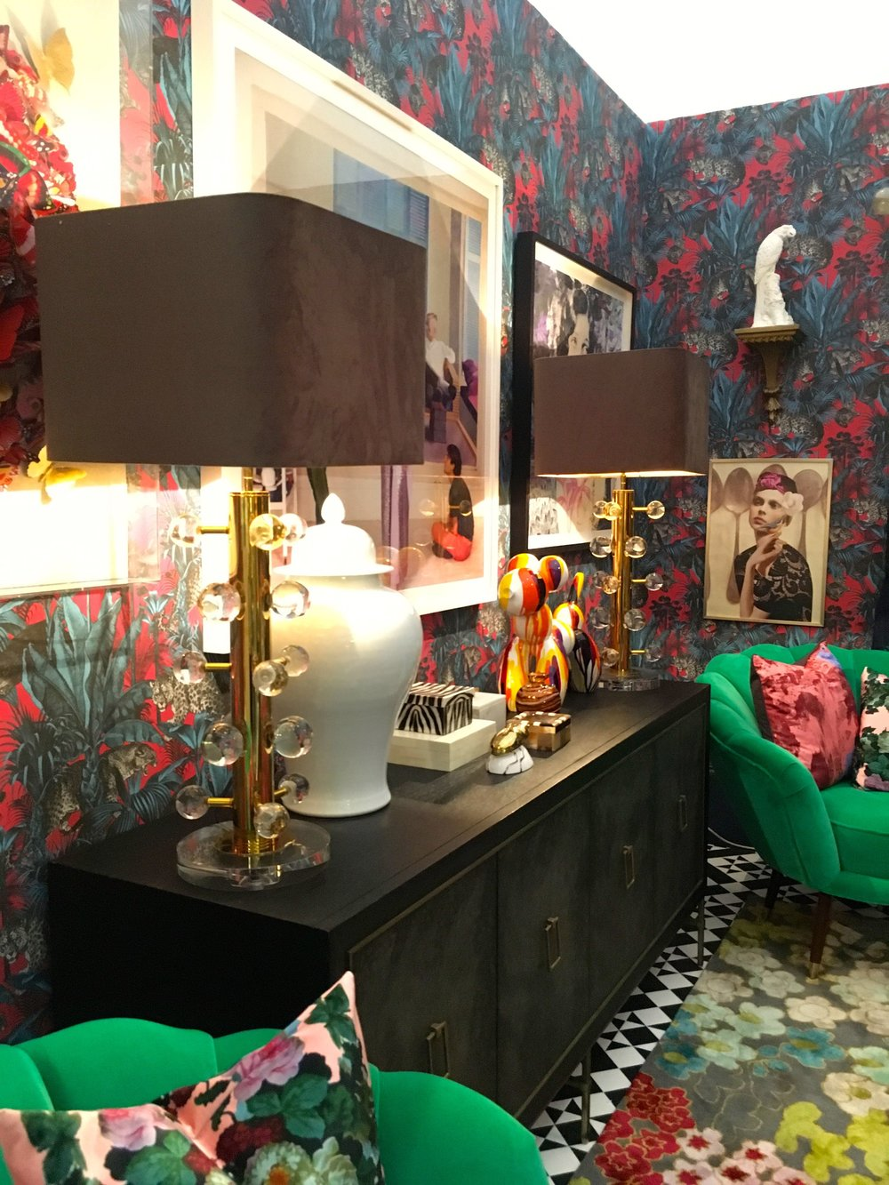 A sideboard, patterned carpet and jade armchairs in the room set from Grand Designs Live