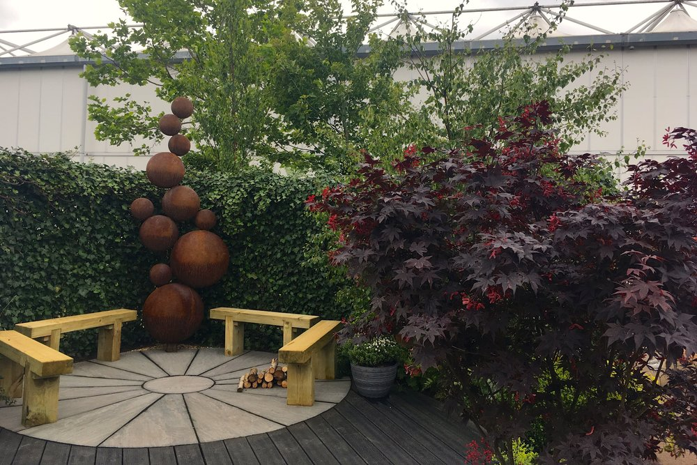 A round seating area in the The Round Garden at Gardener's World Live