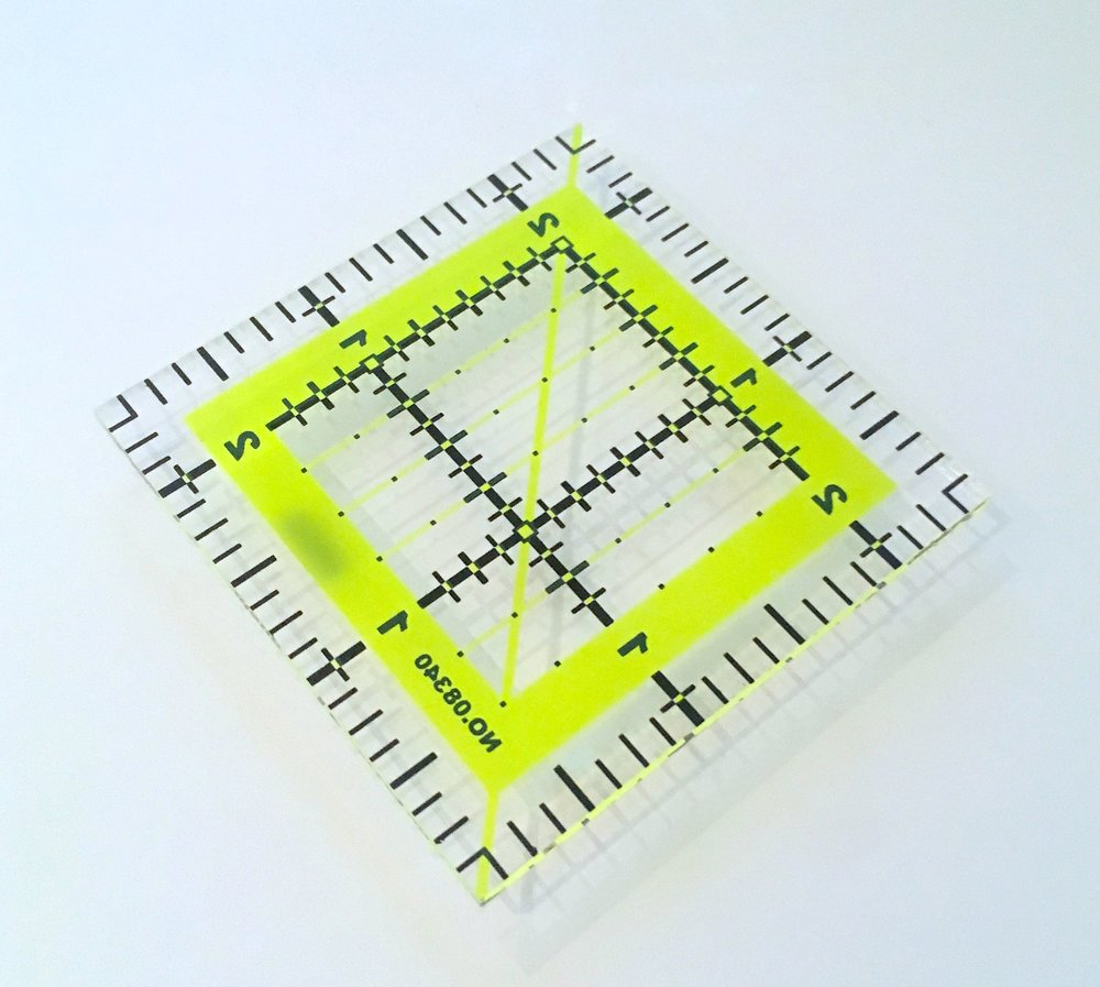 a perspex 2.5 inch template, which was a real help cutting out my quilt