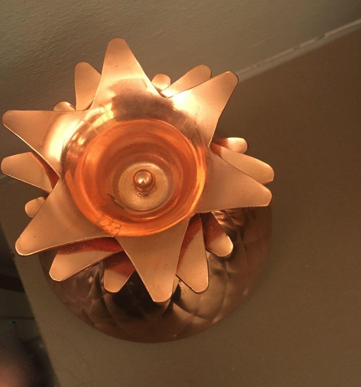 A golden pineapple lid