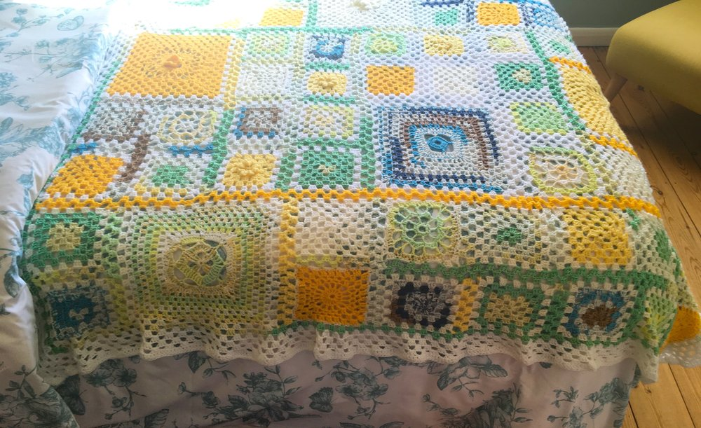 Spring crochet granny square blanket is complete
