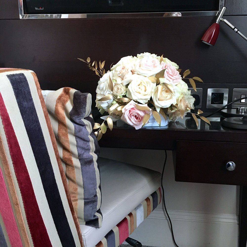 A desk an upholstered chair