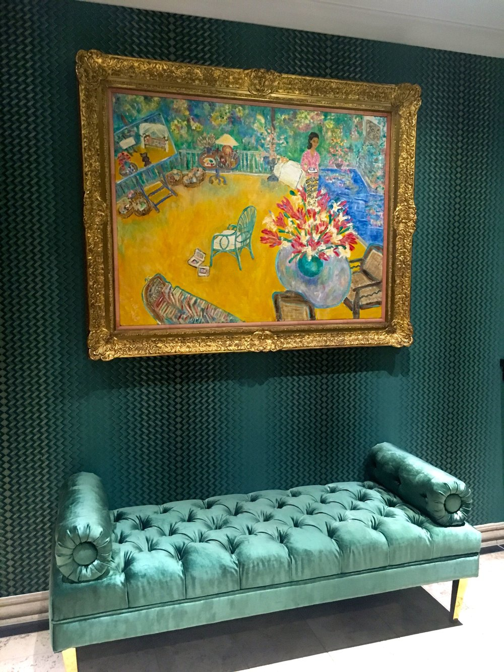 The painting is still there and joined by an emerald padded seat