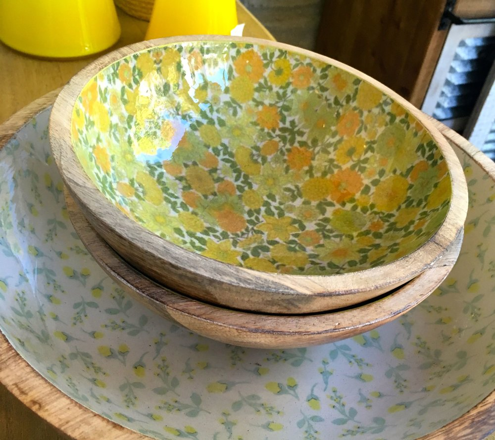 Wooden bowls underneath with a patterned interior