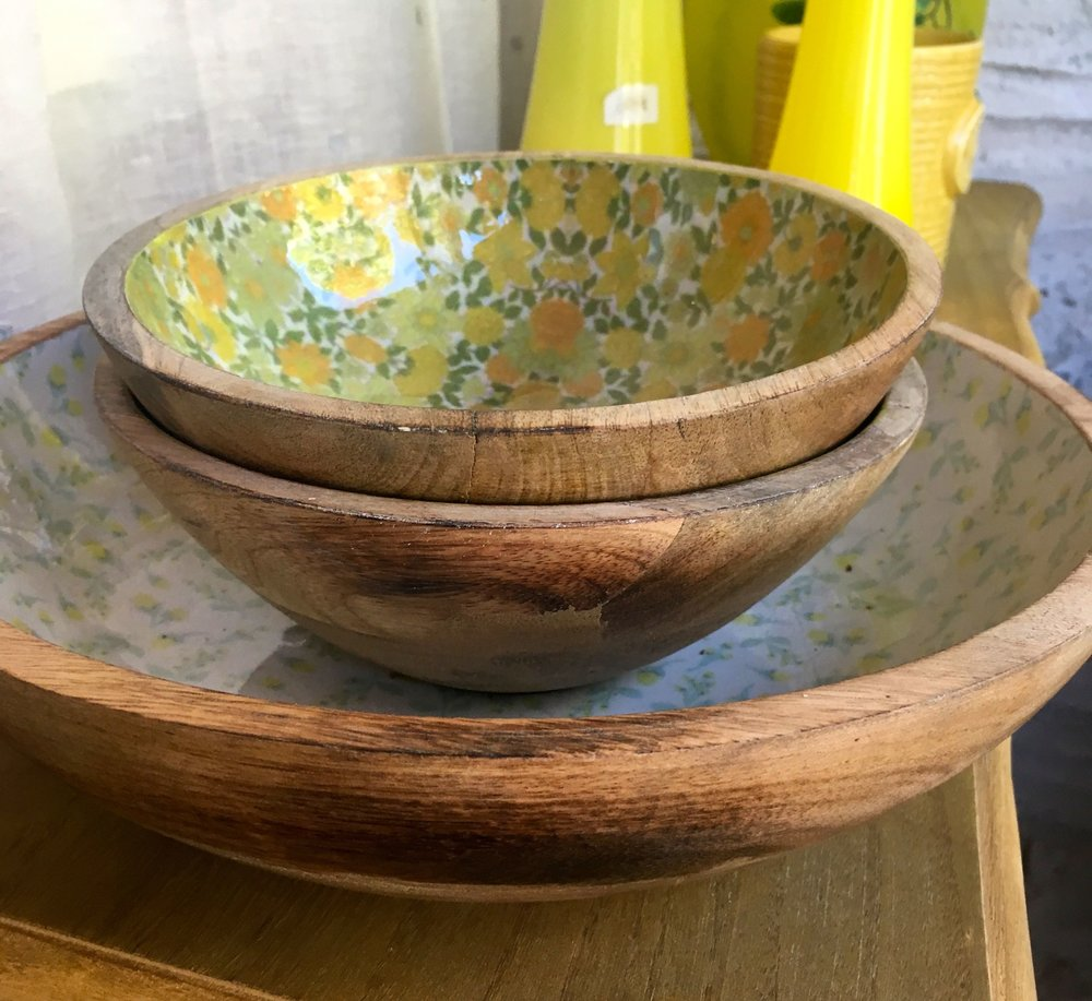 A sideview of the wooden and patterned bowls