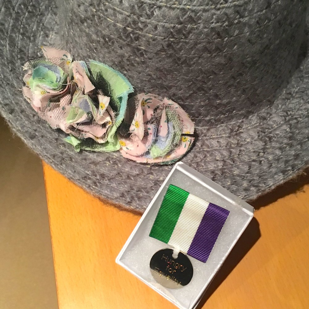 Hungry for Equality medal and fabric flowers on my hat
