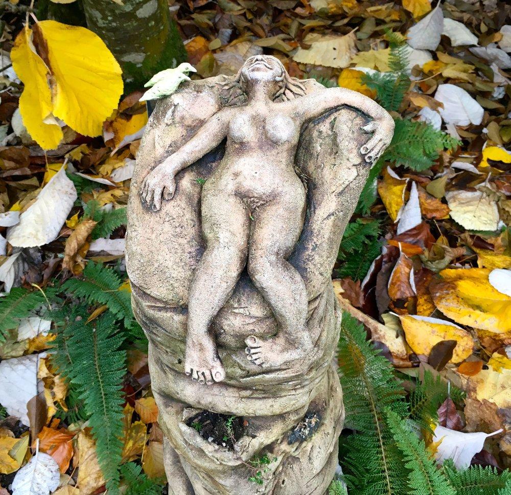 A sculpture relaxing in RHS Rosemoor