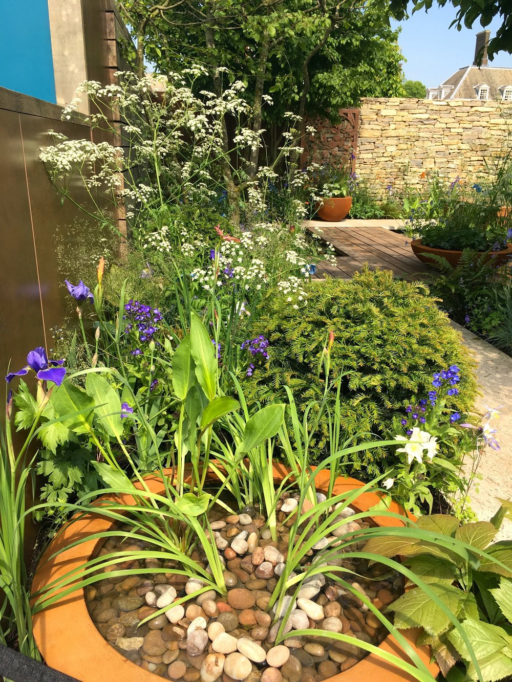 pebbles water and copper - a winning combination in this space to grow garden