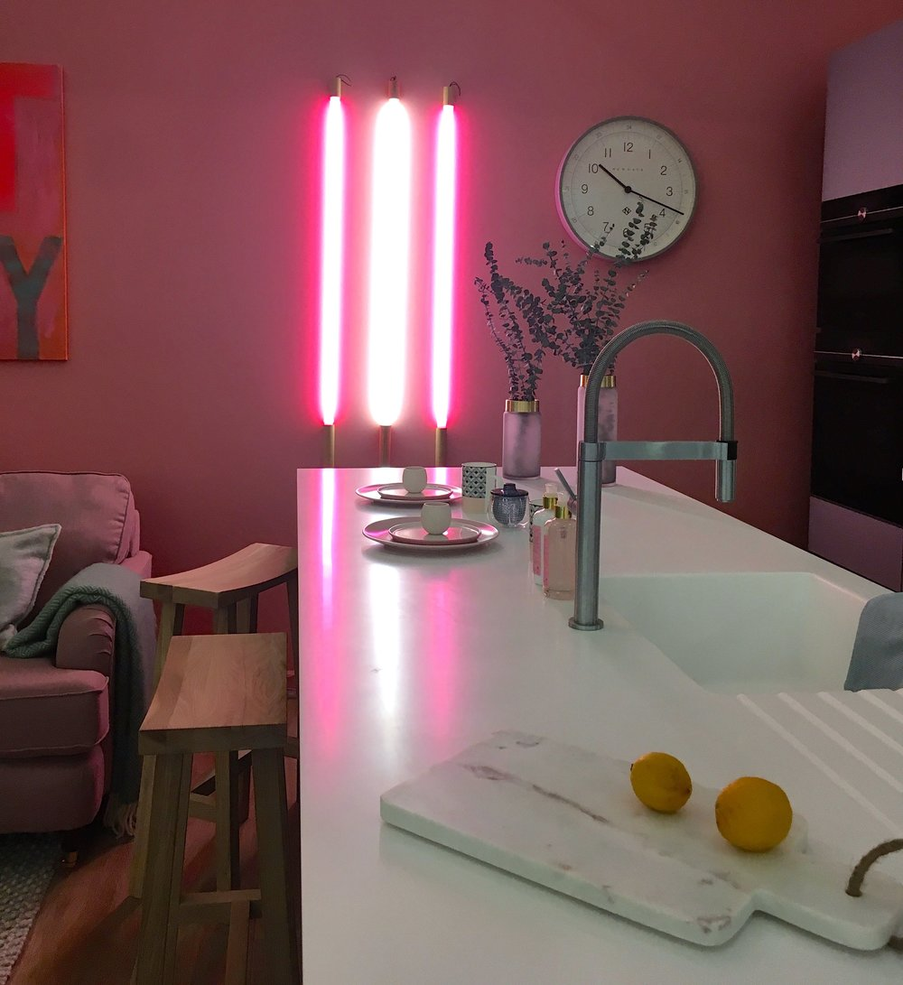 neon lights in the room set at the ideal home show