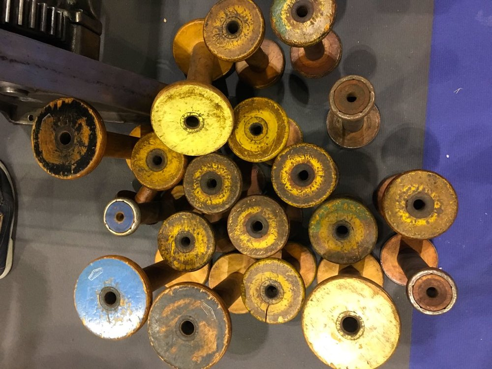 top down view of the wooden bobbins