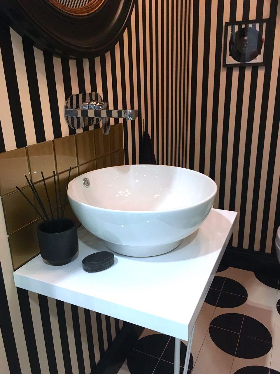 Spots stripes and a brilliant white washbasin
