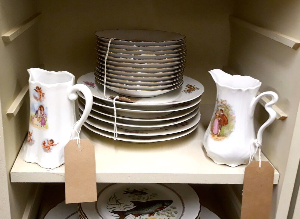 stacks of crockery, edged with gold