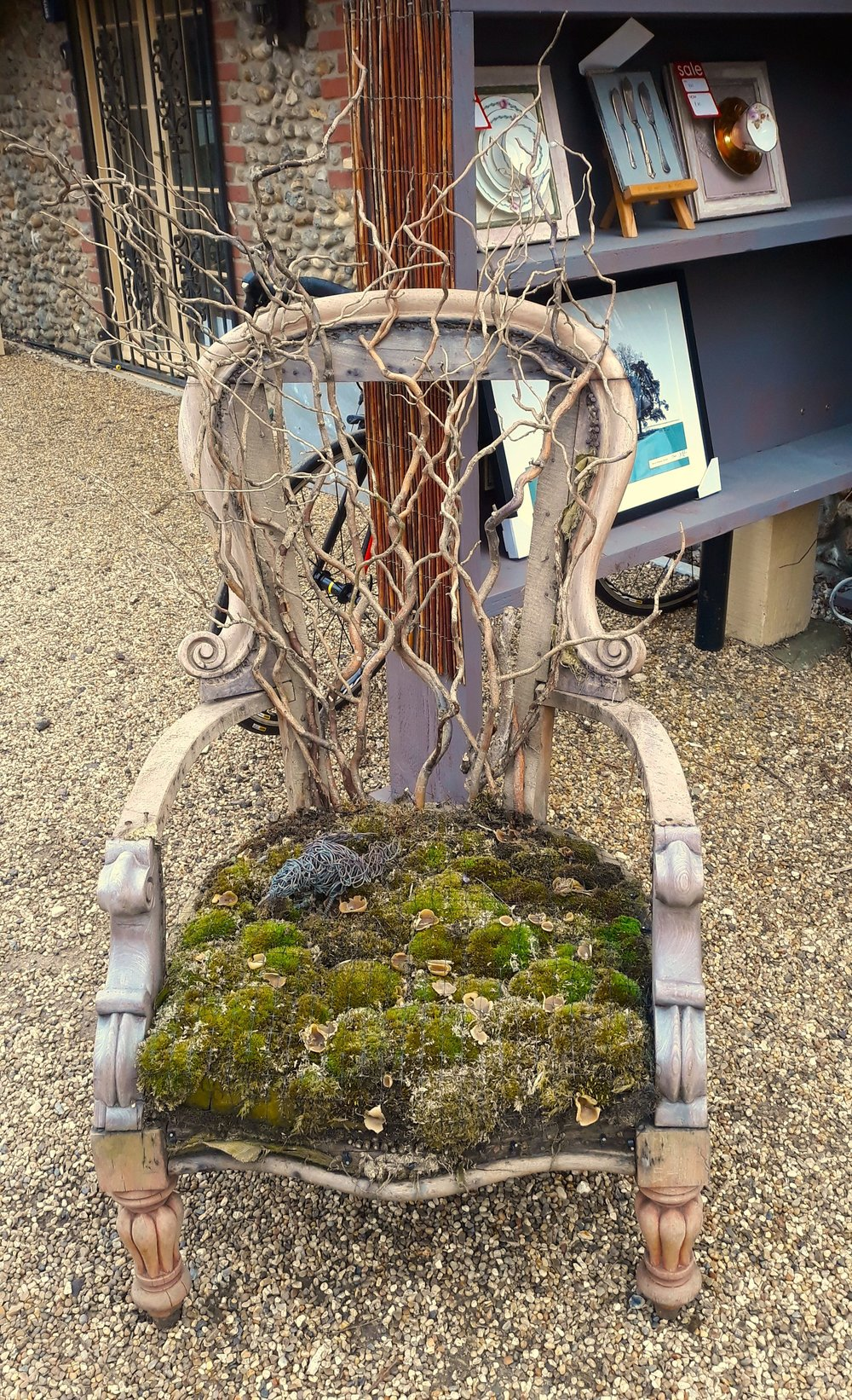 Succulents replace the seat cushion in this chair at Creake Abbey