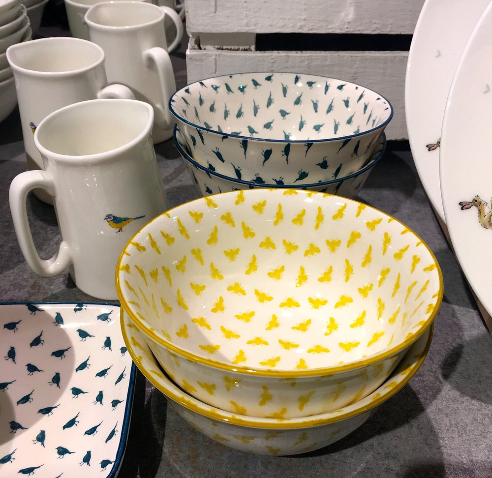 small repeating patterns, yellow butterflies, teal birds
