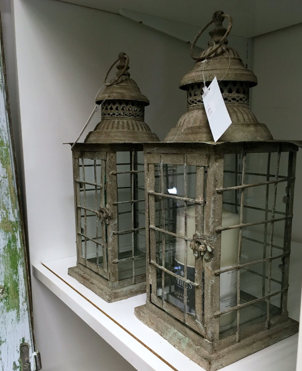 weathered lanterns with candles