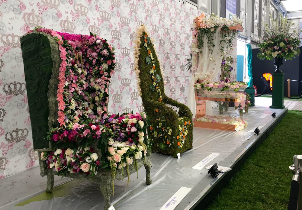 More of an armchair covered in flowers than a throne