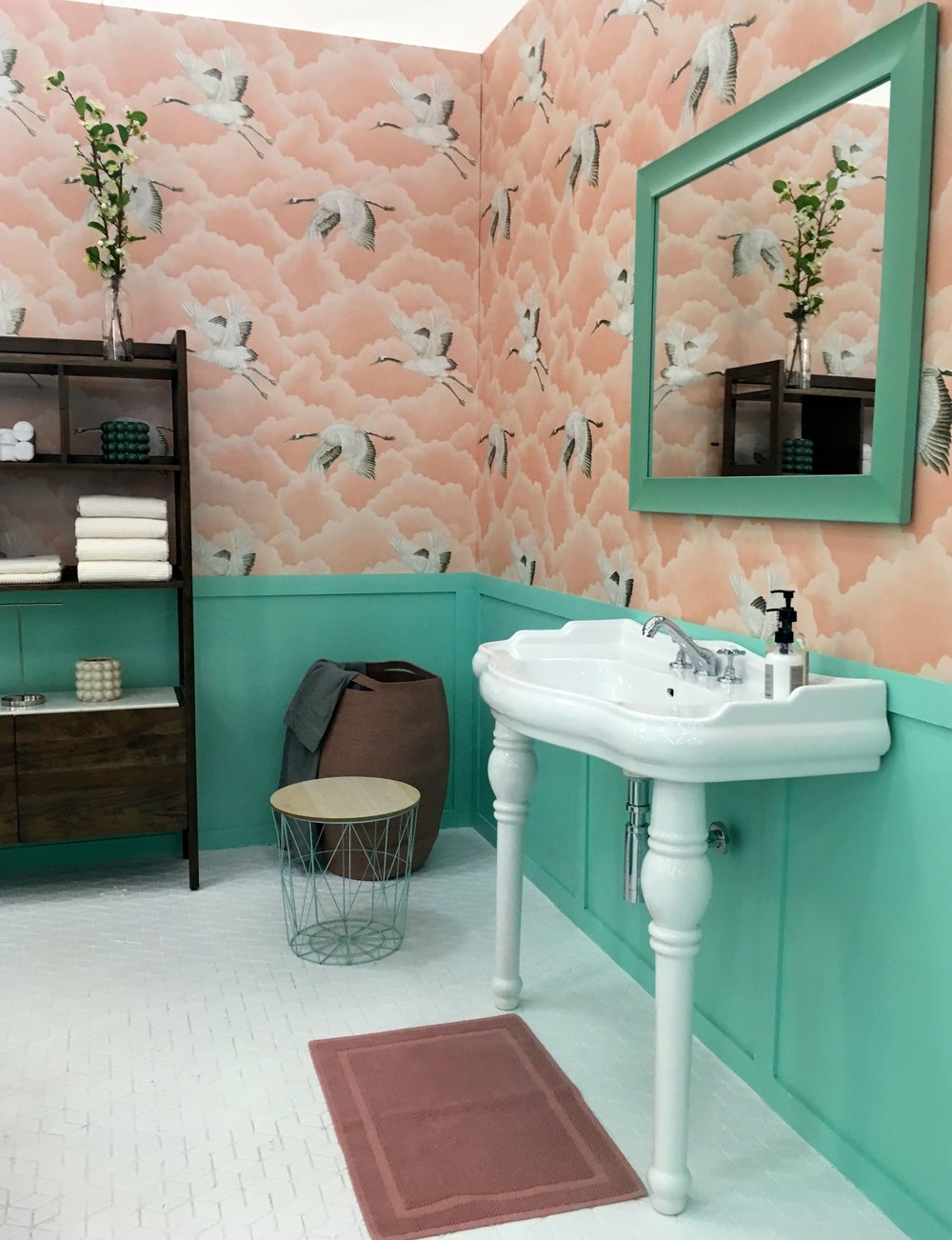 panelling painted green and a white scalloped sink at the Ideal Home Show